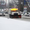 A city maintenance truck is used to remove snow and apply treatment along Green River Road in Evansville, Ind., Tuesday, Feb. 4, 2014. A Winter Storm Warning was issued Tuesday as a mixture of snow, sleet and rain continued into the evening with temperatures around 30 degrees. (AP Photo/The Evansville Courier & Press, Jason Clark)