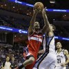 Washington Wizards forward Trevor Ariza (1) goes to the basket over Memphis Grizzlies\' Marc Gasol, of Spain, as Grizzlies\' Tayshaun Prince (21) watches during the first half of an NBA basketball game in Memphis, Tenn., Friday, Feb. 1, 2013. (AP Photo/Danny Johnston)
