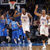 Oklahoma City\'s Serge Ibaka (9) and Russell Westbrook (0) react after a Thunder three point shot during the NBA basketball game between the Oklahoma City Thunder and the Dallas Mavericks at Chesapeake Energy Arena in Oklahoma City, Okla. on Wednesday, Nov. 6, 2013. Photo by Chris Landsberger, The Oklahoman