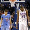 Oklahoma City\'s Kevin Durant reacts as he walks up the court in front of Los Angeles\' Blake Griffin (32) during the NBA game between the Oklahoma City Thunder and the Los Angeles Clippers at the Chesapeake Energy Arena, Sunday, Feb. 23, 2014. Photo by Sarah Phipps, The Oklahoman