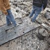Residents walk over what use to be the front door to their home as they search for salvageable remains from the home that was destroyed by wildfires on Friday, April 10, 2009, in Choctaw, Okla. Photo by Chris Landsberger, The Oklahoman
