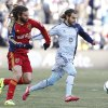 Photo - Real Salt Lake midfielder Kyle Beckerman, left, and Sporting Kansas City forward Graham Zusi, right, battle for the ball during the first half of the MLS Cup final soccer match in Kansas City, Kan., Saturday, Dec. 7, 2013. (AP Photo/Colin E. Braley)