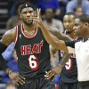 Photo - Miami Heat forward LeBron James (6) reacts to an official's call in the first half of an NBA basketball game Wednesday, April 9, 2014, in Memphis, Tenn. (AP Photo/Mark Humphrey)