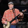 Photo - FILE - In this May 3, 2009 file photo, musician Pete Seeger performs at a benefit concert celebrating his 90th birthday at Madison Square Garden in New York. A five-day festival honoring the late folk singer will feature music, film and remembrances in New York City and the Hudson Valley. Seeger grandson Kitama Cahill-Jackson says Wednesday, April 30, 2014, the free