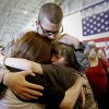 Spc. Tadd Hendrickson is greeted by his mother Kendra Beller, left, and his brother Trevor Rutledge, 12, after returning from Kuwait with the Oklahoma National Guard\'s 180th Cavalry Squadron at the Will Rogers Air National Guard Base in Oklahoma City, Saturday, March 31, 2012. A homecoming ceremony welcomed about 180 soldiers from the Oklahoma National Guard\'s 180th Cavalry Squadron returning from Kuwait along with members of the Oklahoma National Guard\'s 45th Infantry Brigade Combat Team returning from Afghanistan. Photo by Bryan Terry, The Oklahoman