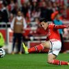 Photo - Benfica's Enzo Perez shoots to score their third goal during their Portuguese league soccer match with Academica Sunday, March 23 2014, at Benfica's Luz stadium in Lisbon. (AP Photo/Armando Franca)