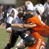 Oklahoma State\'s James Castleman (91) and Oklahoma State\'s Caleb Lavey (45) bring down Texas\' Joe Bergeron (24) during a college football game between Oklahoma State University (OSU) and the University of Texas (UT) at Boone Pickens Stadium in Stillwater, Okla., Saturday, Sept. 29, 2012. Photo by Bryan Terry, The Oklahoman