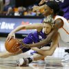 Oklahoma State\'s Toni Young (15) reaches over TCU\'s Kamy Cole (11) for the ball during a women\'s college basketball game between Oklahoma State University and TCU at Gallagher-Iba Arena in Stillwater, Okla., Tuesday, Feb. 5, 2013. Oklahoma State won 76-59. Photo by Bryan Terry, The Oklahoman