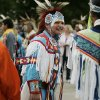 Willie Nelson (Comanche and Cheyenne), 14, center, from Stillwater, Oklahoma, talks with friend Wolf Leitka (Creek and Seminole), 15, right, from Norman, Oklahoma, while waiting for the start of the Red Earth parade to begin on Friday, June 6, 2008