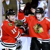 Chicago Blackhawks left wing Patrick Sharp, left, and right wing Patrick Kane celebrate Kane\'s goal during the third period of an NHL hockey game against the Minnesota Wild, Tuesday, March 5, 2013 in Chicago. The Blackhawks won 5-3. (AP Photo/Brian Kersey)