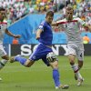 Photo - Bosnia's Edin Dzeko, center, gets in a shot despite the challenge of Iran's Jalal Hosseini, right, during the group F World Cup soccer match between Bosnia and Iran at the Arena Fonte Nova in Salvador, Brazil, Wednesday, June 25, 2014. (AP Photo/Sergei Grits)