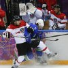 Photo - Austria forward Andreas Nodl collides with Slovenia forward Anze Kopitar in the first period of a men's ice hockey game at the 2014 Winter Olympics, Tuesday, Feb. 18, 2014, in Sochi, Russia. (AP Photo/Julio Cortez)