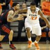 Oklahoma State\'s Marcus Smart (33) drives the ball on a fast break against Texas Tech\'s Josh Gray (5) during a men\'s college basketball game between Oklahoma State University and Texas Tech at Gallagher-Iba Arena in Stillwater, Okla., Saturday, Jan. 19, 2013. OSU won, 79-45. Photo by Nate Billings, The Oklahoman