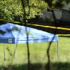 Photo -   A blue tent protects the scene of a fatal shooting on Meeting House Hill Circle in New Fairfield, Conn., Thursday, Sept, 27, 2012. A Connecticut man fatally shot a masked teenager in self-defense during what appeared to be an attempted burglary early Thursday morning, then discovered that he had killed his son, state police said. (AP Photo/The News-Times, Carol Kaliff)