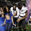 Entertainment Tonight reporter Rocsi Diaz dances with Baltimore Ravens linebacker Ray Lewis during media day for the NFL Super Bowl XLVII football game Tuesday, Jan. 29, 2013, in New Orleans. (AP Photo/Mark Humphrey)