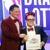 Photo - Cleveland Cavaliers owner Dan Gilbert poses with his son Nick Gilbert after winning the NBA basketball draft lottery, Tuesday, May 21, 2013 in New York. (AP Photo/Jason DeCrow)