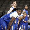 Morehead State center Kenneth Faried, front, takes a breather with teammates during practice at the Pepsi Center in Denver on Wednesday, March 16, 2011, for their NCAA second round tournament basketball game against Louisville on Thursday. (AP Photo/ Ed Andrieski)