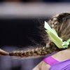 The plait of Belarus\' Victoria Azarenka flies as she serves against German Mona Barthel during their quarterfinal match at the Porsche tennis Grand Prix in Stuttgart, Germany, Friday, April 27, 2012. (AP Photo/Michael Probst) ORG XMIT: PSTU113