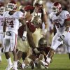 Oklahoma\'s Aaron Colvin (14) celebrates beside R.J. Washington (91) after sacking Florida\'s Clint Trickett (9) during a college football game between the University of Oklahoma (OU) and Florida State (FSU) at Doak Campbell Stadium in Tallahassee, Fla., Saturday, Sept. 17, 2011. Photo by Bryan Terry, The Oklahoman