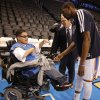 Photo - Brian Davis and Kevin Durant greet Andrew Rains before an NBA basketball game between the Oklahoma City Thunder and the Golden State Warriors at Chesapeake Energy Arena in Oklahoma City, Sunday, Nov. 18, 2012.  Andrew Rains suffers from cerebral palsy, and is attending his first Thunder game.  He never misses a game on television.  Photo by Garett Fisbeck, The Oklahoman