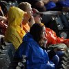 Fans sit in the stands during a rain delay before the Bedlam college baseball game between Oklahoma and Oklahoma State in the Big 12 baseball tournament at the Chickasaw Bricktown Ballpark in Oklahoma City, Friday, May 23, 2014. Photo by Nate Billings, The Oklahoman