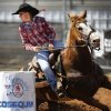 Lauren Belote of Enola, AR, pulls back on the reins as she maneuvers her horse around a barrel in barrel racing competition during the morning go-round at the IFYR rodeo on Thursday, July 11, 2013. July 10, 2013. Photo by Jim Beckel, The Oklahoman.