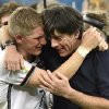 Photo - Germany's Bastian Schweinsteiger and Germany's head coach Joachim Loew embrace after the World Cup final soccer match between Germany and Argentina at the Maracana Stadium in Rio de Janeiro, Brazil, Sunday, July 13, 2014. Germany won the match 1-0 (AP Photo/Martin Meissner)