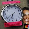 A mask depicting Britain\'s Duchess of Cambridge and a clock showing New York time, which were placed by members of the media, is seen across St. Mary\'s Hospital exclusive Lindo Wing in London, Sunday, July 21, 2013. Media are preparing for royal-mania as the Duchess is expected to give birth to the new third-in-line to the throne in mid-July, at the Lindo Wing. Cameras from all over the world are set to be jostling outside for an exclusive first glimpse of Britain\'s Prince William and the Duchess of Cambridge\'s first child. (AP Photo/Lefteris Pitarakis)