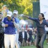Photo - Jenny Shin, left, Meena Lee, center, and Illhee Lee, right, spray Champion Inbee Park after she won the Wegmans LPGA golf championship in Pittsford, N.Y., Sunday, Aug. 17, 2014. Park won in a sudden death playoff round. (AP Photo/Gary Wiepert)