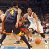 Oklahoma City\'s Russell Westbrook (0) drives the ball in front of Golden State\'s Anthony Randolph (4) during the first half of the NBA basketball game between the Oklahoma City Thunder and the Golden State Warriors at the Ford Center on Monday, Dec. 7, 2009, in Oklahoma City, Okla. Photo by Chris Landsberger, The Oklahoman ORG XMIT: KOD