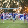 SW Covenant Patriots vs. Ryan Cowboys. September 19, 2014 A.J. Wheeler busts through the Patriots sign as the team runs on the field. by Mitzi Aylor #newsoknow #VarsityFootball
