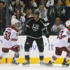 Photo - Los Angeles Kings center Jordan Nolan, center, celebrates his goal as Phoenix Coyotes defenseman Derek Morris, left, and center Mike Ribeiro look on during the first period of their NHL hockey game on Thursday, Oct. 24, 2013, in Los Angeles. (AP Photo/Mark J. Terrill)