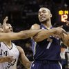 Memphis Grizzlies\' Jerryd Bayless (7) is fouled by San Antonio Spurs\' Tim Duncan, left, during the first quarter of an NBA basketball game, Saturday, Dec. 1, 2012, in San Antonio. Spurs\' Gary Neal (14) helps defend on the play. (AP Photo/Eric Gay)