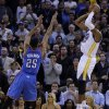 Golden State Warriors\' Andre Iguodala, right, shoots the game-winning shot over Oklahoma City Thunder\'s Thabo Sefolosha (25) during the second half of an NBA basketball game Thursday, Nov. 14, 2013, in Oakland, Calif. (AP Photo/Ben Margot)