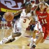 Oklahoma\'s Aaryn Ellenberg (3) drives to the basket as Marist\'s Leanne Ockenden (11) defends during the women\'s college basketball game between the University of Oklahoma and Marist at Lloyd Noble Center in Norman, Okla., Sunday,Dec. 2, 2012. Photo by Sarah Phipps, The Oklahoman