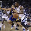 Memphis Grizzlies\' Mike Conley, right, drives against Golden State Warriors\' Stephen Curry during the first half of an NBA basketball game Friday, Nov. 2, 2012, in Oakland, Calif. (AP Photo/Ben Margot)