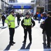 Photo - Police stand by near the finish line ahead of Monday's 118th Boston Marathon, Sunday, April 20, 2014, in Boston. Massachusetts Gov. Deval Patrick says officials are striking a balance between more security and maintaining the city's festive spirit.   (AP Photo/Matt Rourke)