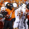 Oklahoma State\'s Daytawion Lowe (8) comes out with the ball after Texas\' final touchdown during a college football game between Oklahoma State University (OSU) and the University of Texas (UT) at Boone Pickens Stadium in Stillwater, Okla., Saturday, Sept. 29, 2012. Oklahoma State lost 41-36. Photo by Bryan Terry, The Oklahoman