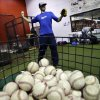 Photo - In this Feb. 24, 2014 photo, Kansas City Royals minor league pitcher John Walter, of Haddonfield, N.J., warms up at Power Train Sports Institute's AFC Baseball & Softball Academy in Cherry Hill, N.J.  (AP Photo/Mel Evans)