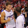 Los Angeles Clippers forward Blake Griffin, left, congratulates guard Chris Paul after defeating the Golden State Warriors in Game 7 of an opening-round NBA basketball playoff series, Saturday, May 3, 2014, in Los Angeles. The Clippers won 126-121. (AP Photo/Mark J. Terrill)