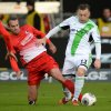 Photo - Freiburg's  Pavel Krmas , left, challenges for the ball with Wolfsburg's  Ivica Olic, during the German first division Bundesliga soccer match between SC Freiburg and VfL Wolfsburg in Freiburg, Germany Sunday Dec. 8, 2013. (AP Photo/dpa, Patrick Seeger)