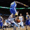 Golden State\'s Ekpe Udoh (20) lands on Oklahoma City\'s Nick Collison (4) as Golden State\'s Stephen Curry (30), left, and Monta Ellis (8) look on along with Oklahoma City\'s Russell Westbrook (0) during the NBA basketball game between the Oklahoma City Thunder and the Golden State Warriors at the Chesapeake Energy Arena in Oklahoma City, Friday, Feb. 17, 2012. Photo by Nate Billings, The Oklahoman