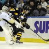 Photo - Pittsburgh Penguins'  Marc-Andre Fleury (29) battles for the puck with Buffalo Sabres' Zemgus Girgensons (28) during the first period of an NHL hockey game in Buffalo, N.Y., Wednesday, Feb. 5,  2014. (AP Photo/Gary Wiepert)
