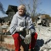 Photo - Linda Sadler, sister of the owner of this home which burned at 1001 Pacific Dr. in Choctaw, Oklahoma, sifts through the charred rubble for salvageable items, Saturday, April 11, 2009. Photo by Paul Hellstern, The Oklahoman