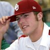 NATIONAL SIGNING DAY / SIGN: Blake Bell puts on an OU hat after signing a letter of intent to attend the University of Oklahoma at Bishop Carroll High School in Wichita Ks., on Wednesday, Feb. 3, 2010. Photo by John Clanton, The Oklahoman