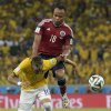 Photo - Brazil's Neymar is fouled by Colombia's Juan Zuniga during the World Cup quarterfinal soccer match between Brazil and Colombia at the Arena Castelao in Fortaleza, Brazil, Friday, July 4, 2014. Brazil's team doctor says Neymar will miss the rest of the World Cup after breaking a vertebrae during the team's quarterfinal win over Colombia. (AP Photo/Manu Fernandez)