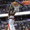 Washington Wizards center Emeka Okafor (50) dunks over Miami Heat\'s Terrel Harris, left, and Rashard Lewis (9) during the second half of an NBA basketball game, Tuesday, Dec. 4, 2012, in Washington. The Wizards won 105-101. (AP Photo/Nick Wass)