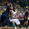Photo - Baylor's Rico Gathers (2) drives into Long Beach State's Kyle Richardson (34) during the first half of an NIT first-round college basketball game in Waco, Texas, Wednesday, March 20, 2013. (AP Photo/Waco Tribune Herald, Jerry Larson)