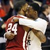 Oklahoma\'s Romero Osby (24) hugs San Diego State\'s Jamaal Franklin (21) after a game between the University of Oklahoma and San Diego State in the second round of the NCAA men\'s college basketball tournament at the Wells Fargo Center in Philadelphia, Friday, March 22, 2013. San Diego State beat OU, 70-55. Photo by Nate Billings, The Oklahoman