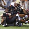 The Florida State defense stops Oklahoma State\'s Desmond Roland (26) during the college football game between Oklahoma State University (OSU) and Florida State University (FSU) at the AdvoCare Cowboys Classic at AT&T Stadium in Arlington, Texas on Saturday, Aug. 30, 2014. Photo by Chris Landsberger, The Oklahoman